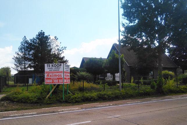 Bedrijfspand met woning te koop in Beringen